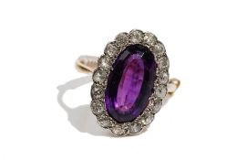 An amethyst and diamond-set dress ring Of oval cluster design,