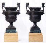 After Claude Ballin, a pair of bronze urns, each with twin-headed Janus handles,