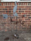 A wrought iron weather vane with cormorant mount, 65cm wide x 118cm high.