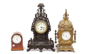 A Victorian Continental gilt brass mantel clock of lantern form, with acanthus moulded finial,