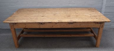 A 19th century Continental pine coffee table, with plank top and end frieze drawers,