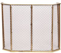 A Victorian brass and copper mesh nursery fire guard, 115cm wide x 90cm high.