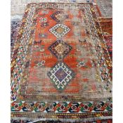 A Kazakh rug, Caucasian, the madder field with four hooked diamonds,
