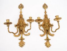 A pair of North European style giltwood twin branch wall sconces, each formed as an Egyptian figure,
