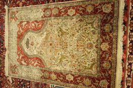 A fine silk keyseri prayer rug, Turkish, the ivory mehrab filled with palmettes,