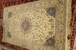 A fine part silk Nain rug, Persian, the ivory field with a central rosette medallion,