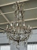 A large gilt metal, glass and cut glass chandelier in the the 18th century style,