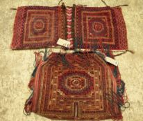 A Tekke Turkman cover, a central gul with minor borders, slit tassels, 53cm x 60cm,