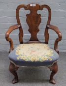 A 19th century child's walnut vase back open armchair, of Queen Anne design, 48cm wide x 69cm high.