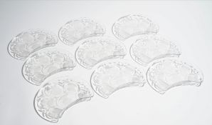 Lalique; a set of eleven glass crescent shaped `thistle' salad plates, mid 20th century,