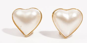 A pair of mabé cultured pearl earclips Of heart shaped design, in a precious yellow metal mounts,