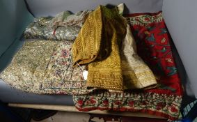 A group of five Middle Eastern textiles, to include a gold embroidered jacket, (5).