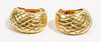 A pair of 18ct gold earclips Of textured lattice half-hoop design, weight 20.