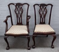 A matched set of twelve George III style mahogany dining chairs on claw and ball feet,