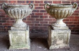 A pair of reconstituted stone,