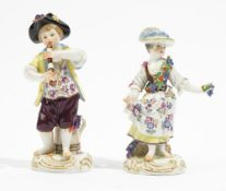 A pair of Meissen figures of vintners, 20th century, a boy playing a recorder,