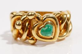 An 18ct gold and emerald ring dress ring by Garrard Of abstract heart design,