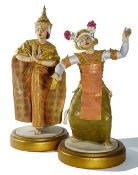 A rare and large pair of Royal Worcester figures of Balinese and Siamese dancers dated 1959,
