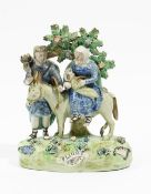 A Walton pearlware group of `Flight To Egypt', circa 1820-30, of traditional form,