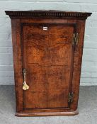 A George III oak and pollard oak wall hanging corner cabinet,