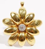 A yellow precious metal and diamond-set pendant brooch of flowerhead design Set with circular-cut