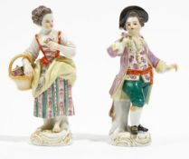 A pair of Meissen figures of gardeners, 20th century, modelled as a youth holding a posy of flowers,