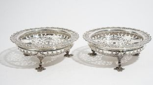Two similar silver sweetmeat stands, each of shaped circular form,