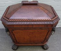 A Regency mahogany canted tapering rectangular wine cooler, with rope twist border and paw feet,
