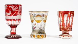 A Bohemian glass spa beaker, late 19th century, enamelled with a courting cup in a landscape,