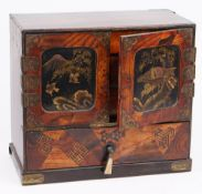 An early 20th century Japanese lacquer and specimen wood table cabinet,