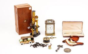 A group of collectables, including a brass students microscope, a Meersham pipe depicting a horse,