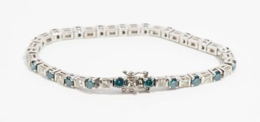 A white gold, treated blue and diamond line bracelet,