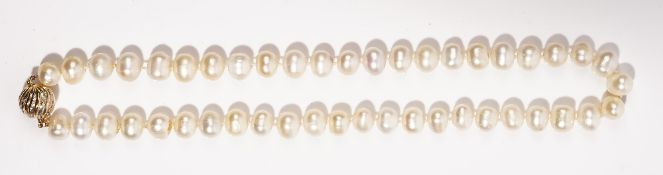 A single row baroque cultured pearl necklace Suspended from a diamond-set spherical gold clasp,