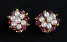 A pair of cultured pearl and ruby caboch