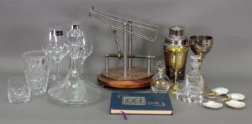 A glass ship's decanter with the crest o