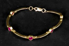 A 9ct gold and ruby set bracelet, the ov