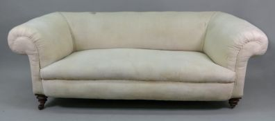 A Victorian upholstered Chesterfield settee, on turned mahogany legs with gilt metal feet,