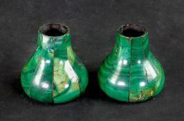 A pair of malachite veneered gilt metal