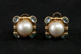 A pair of mabé pearl gold earclips, the central mabé pearls collet set to a shaped square mount,