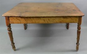 A Victorian waxed pine kitchen table, on