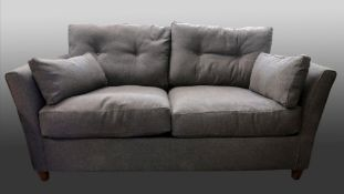 A contemporary two seat bed settee, by J