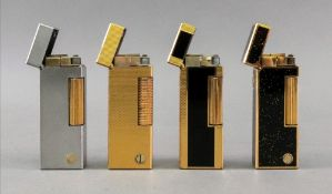 Four Alfred Dunhill lighters, one with brushed finish, one engine turned with repeated lozenges,