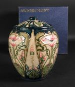 A Moorcroft jar and cover, tube lined wi