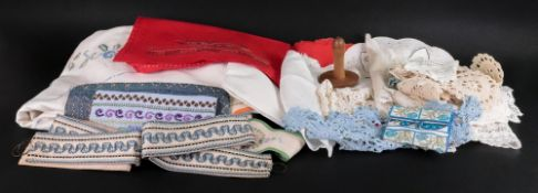 A collection of table linens, comprising