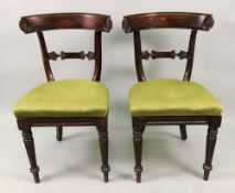 A pair of late Regency faux rosewood din