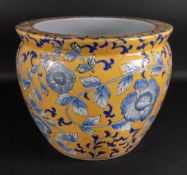 A modern Asian circular jardinière painted with flowering branches against a yellow ground,