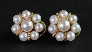 A pair of cultured pearl earclips of clu