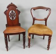 A late Victorian carved mahogany hall ch