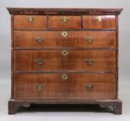 The upper part of a William & Mary walnut tallboy chest, the later top above a moulded frieze,