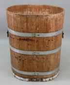 A Chinese painted oval wooden metal bound rice bin, 56cm wide x 45cm deep x 72cm high,